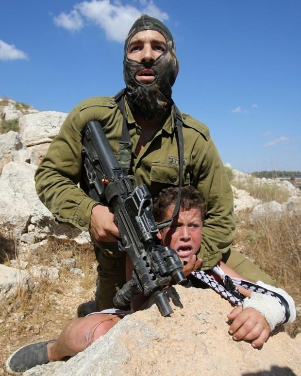 Dünya İsrailli Askerin Acımazlığını Konuşuyor! galerisi resim 14