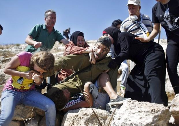 Dünya İsrailli Askerin Acımazlığını Konuşuyor! galerisi resim 6